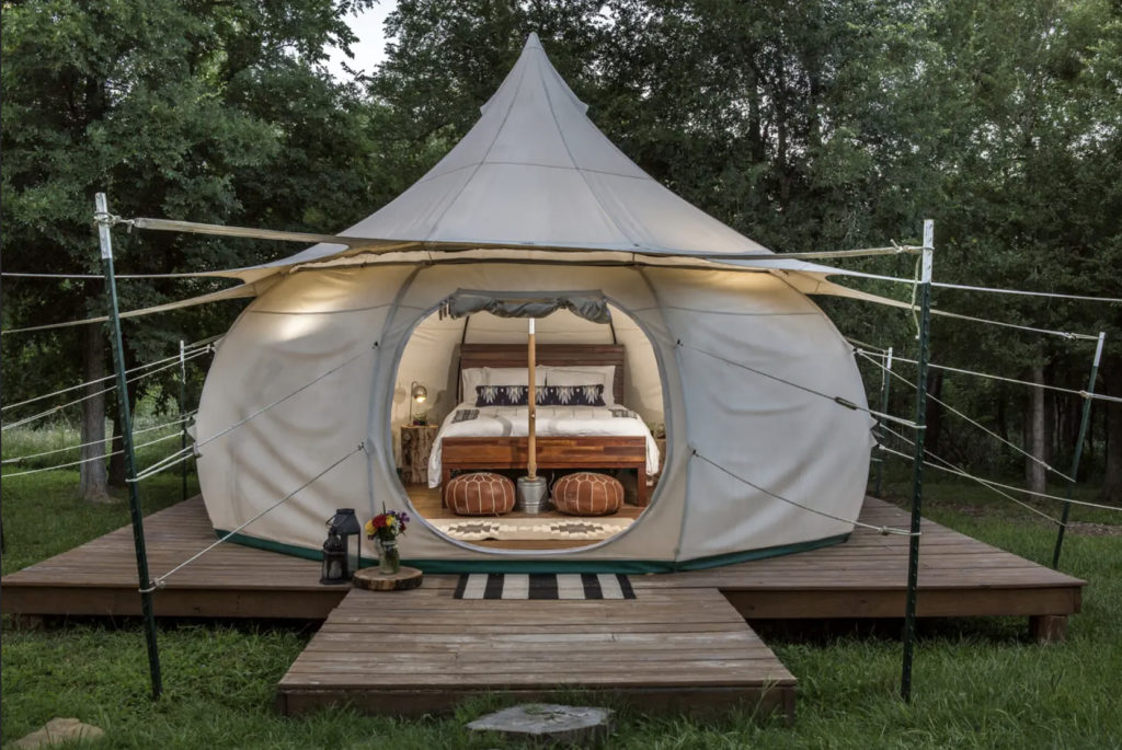 A fully furnished yurt, with rustic-chic designs.